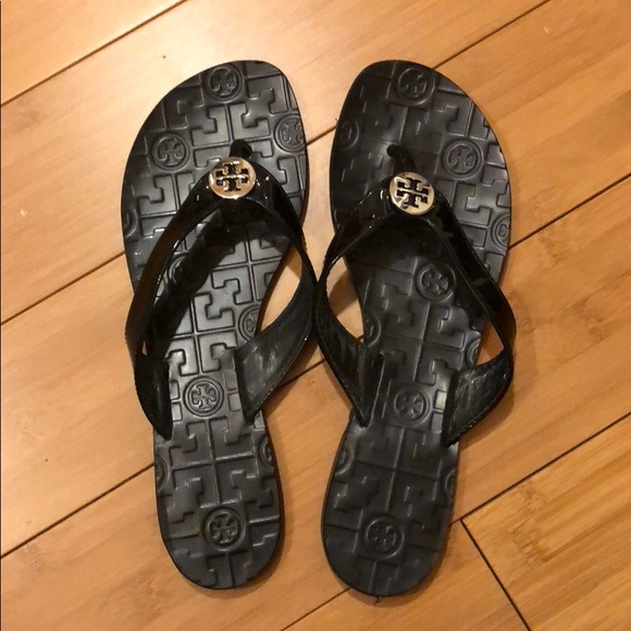 2732d609bc1d11 M 5ab30a365512fd01634c952f. Other Shoes you may like. Tory Burch black  heeled sandals